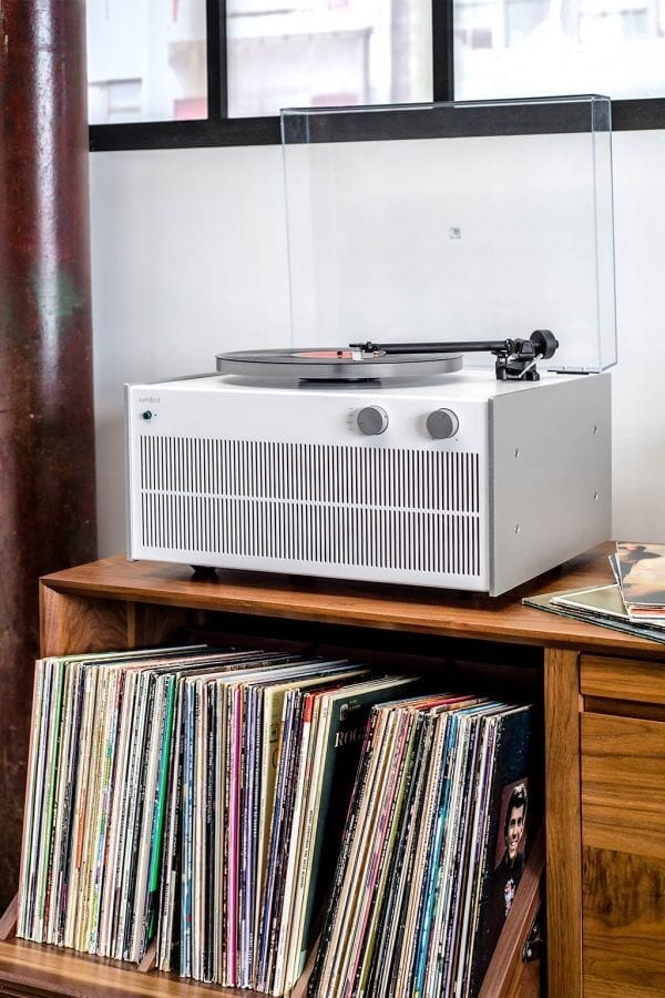 Modern Record Player with bright white and grey themed exterior with a high-fidelity sound from custom hand-built amplifier on a premium Walnut swivel style LP storage cabinet.